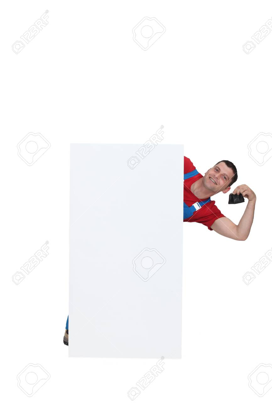 Plumber posing by poster holding purse Stock Photo - 17577497