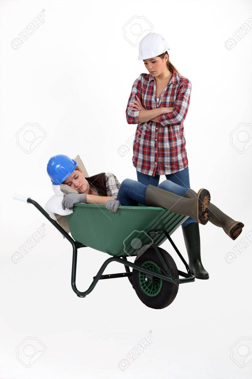 Construction worker discovering her colleague fast asleep Stock Photo - 17578115