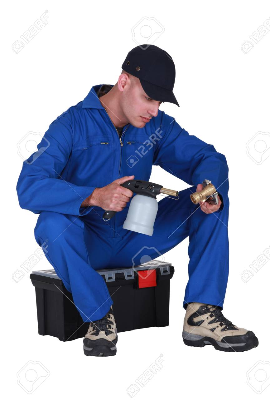 Plumber heating up pipe with blow torch Stock Photo - 17904111