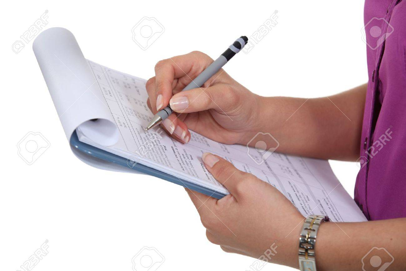 Woman filling in a form - 18740626