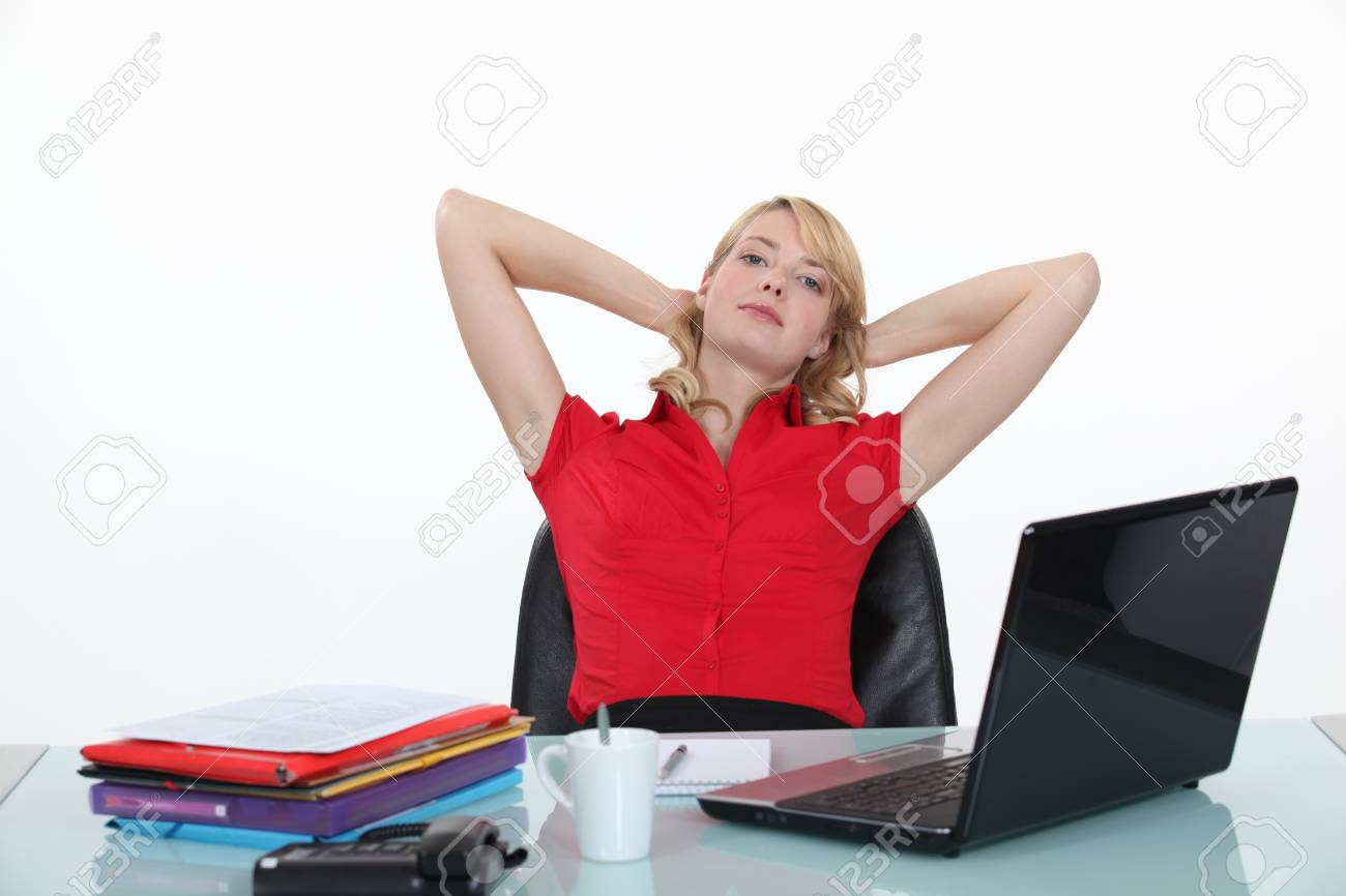 Blond woman relaxing at her desk Stock Photo - 19844902