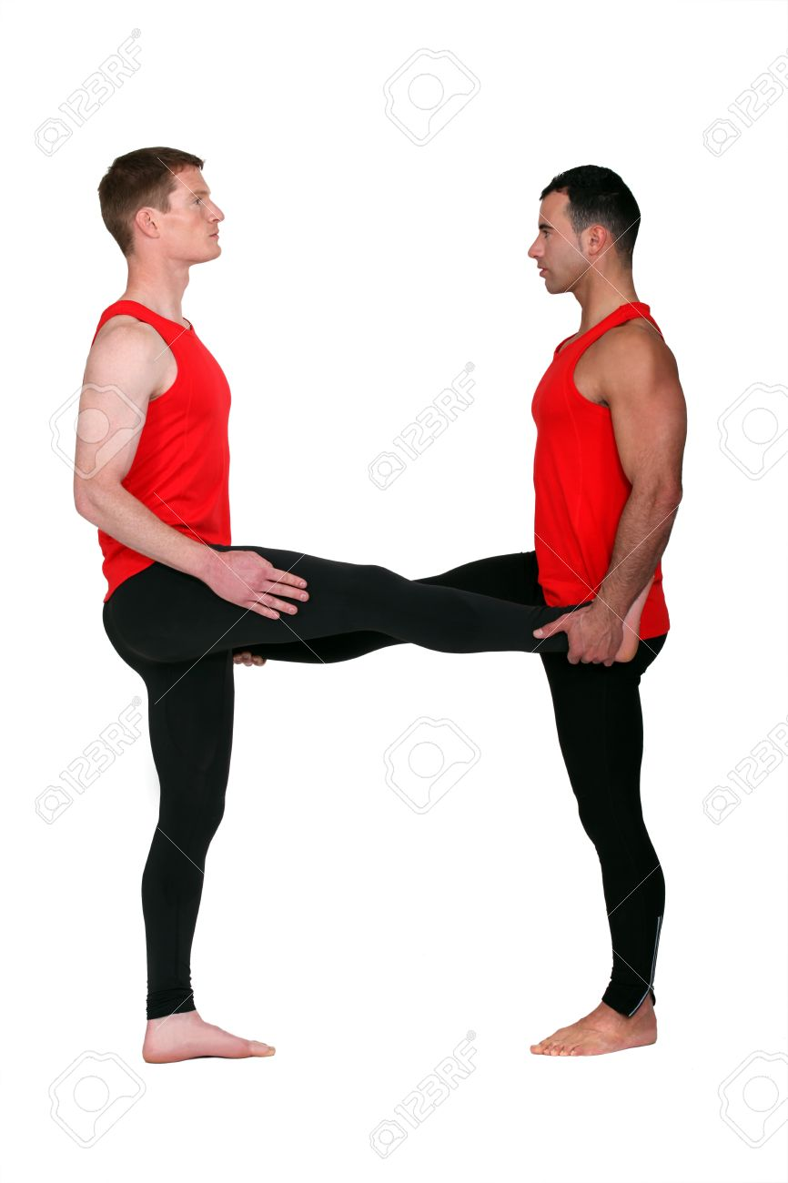 Two male gymnasts stretching Stock Photo - 22031228