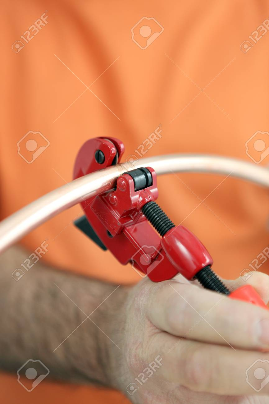 Worker using a tool Stock Photo - 22399916