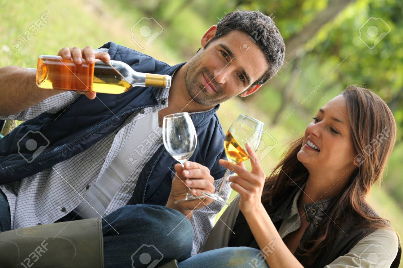 couple with drinks in the countryside Stock Photo - 24082269
