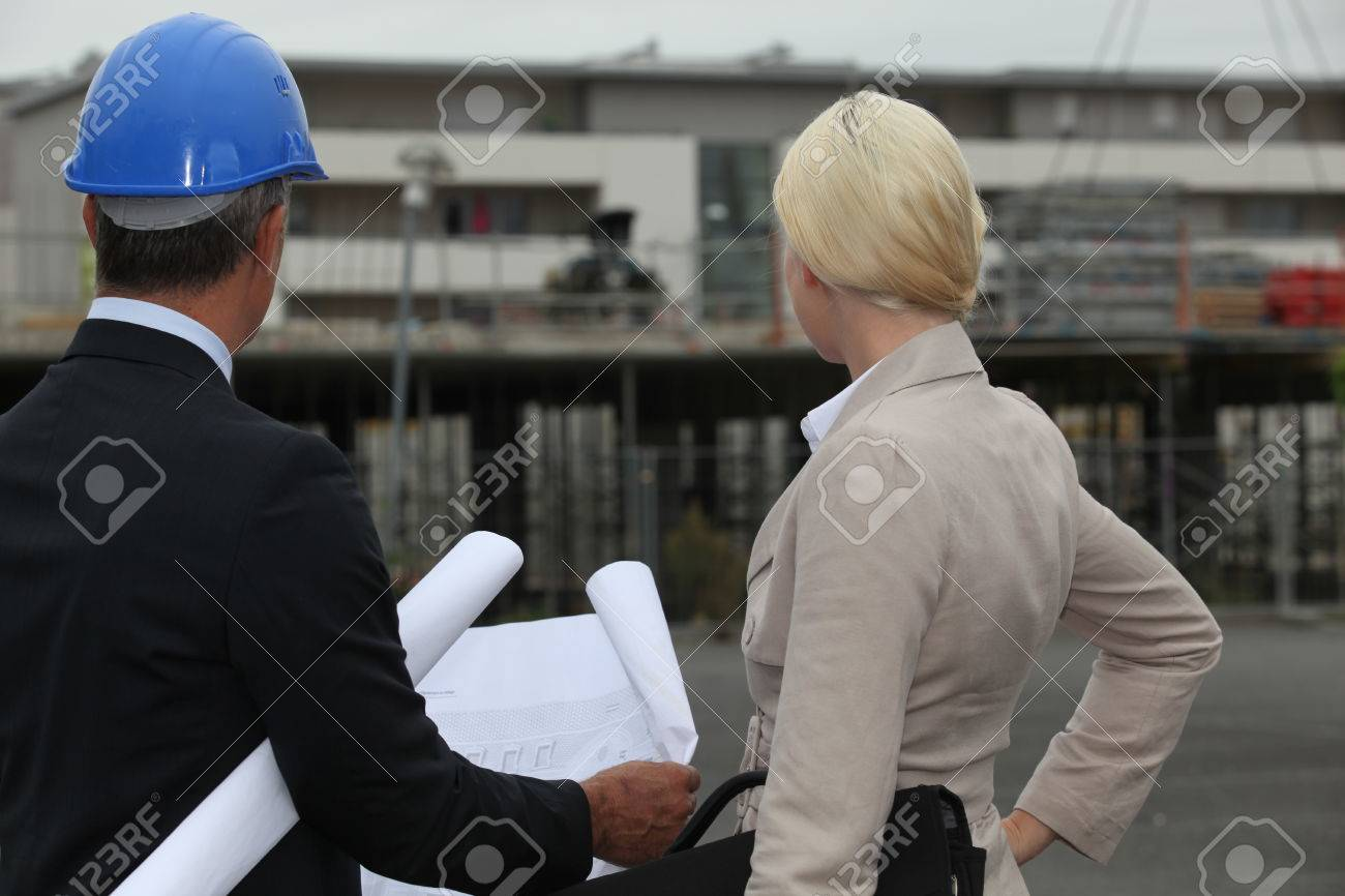 businessman and his assistant on a construction site - 23874074