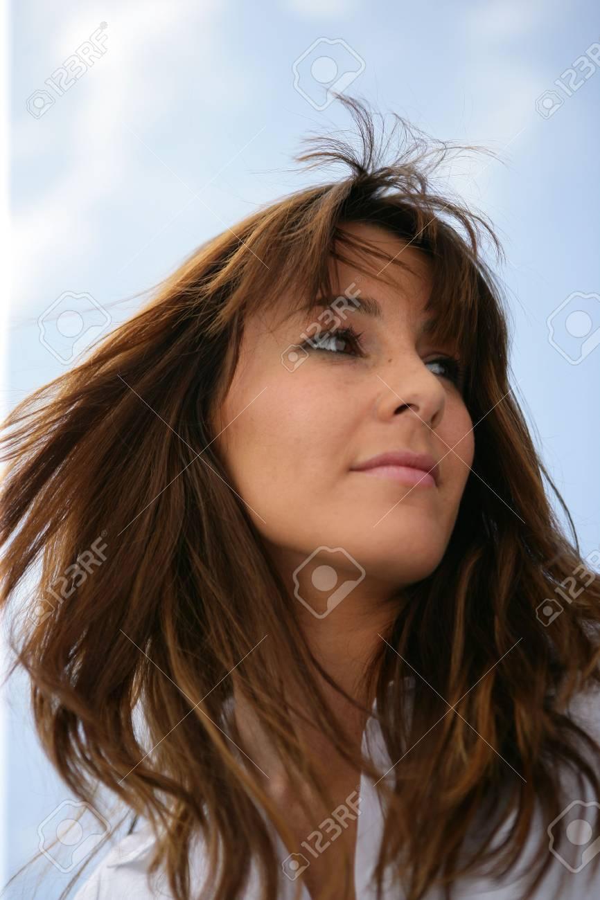 Brunette stood in a breeze Stock Photo - 24093034