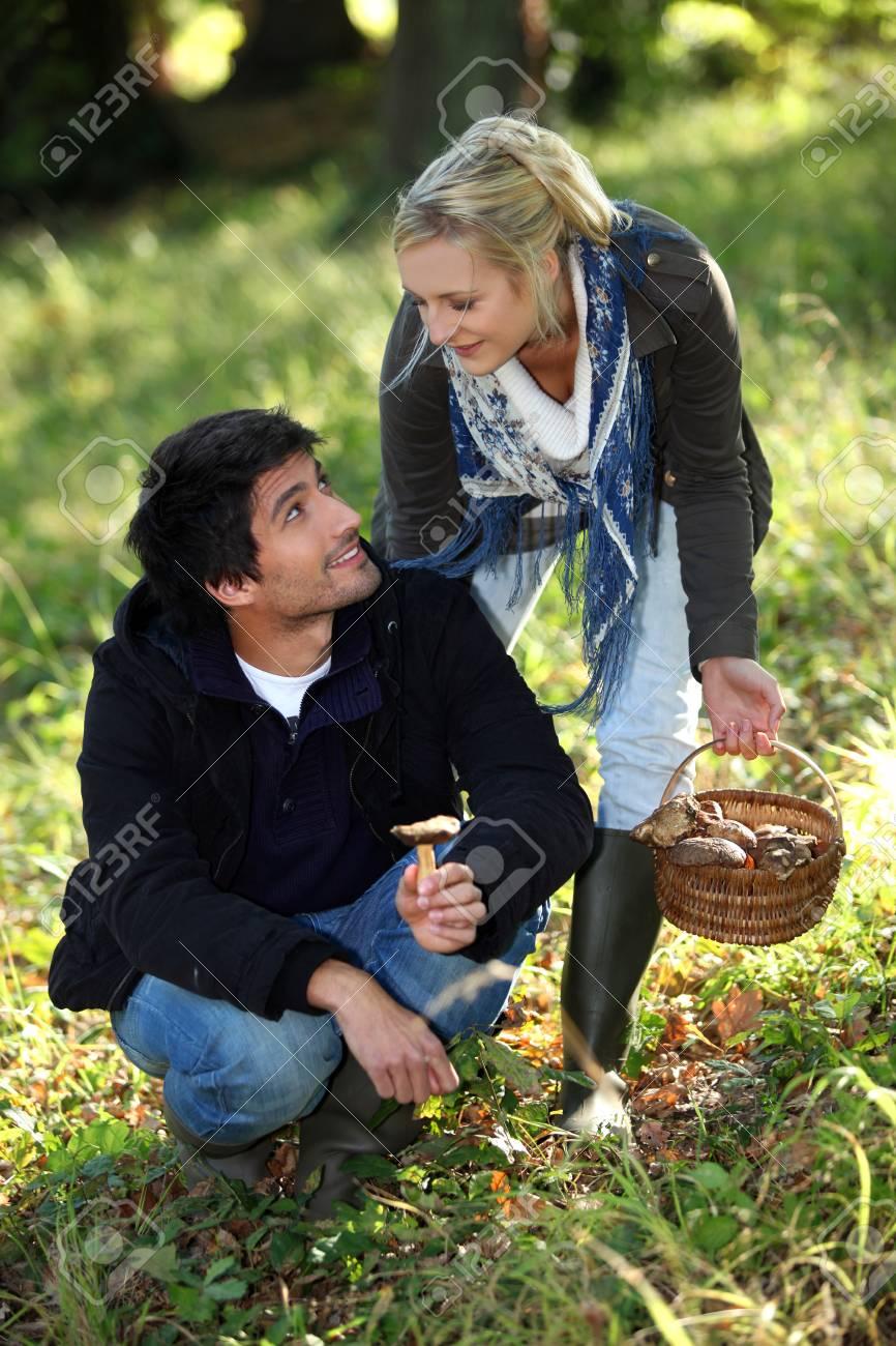 happy couple gathering mushrooms Stock Photo - 26133641
