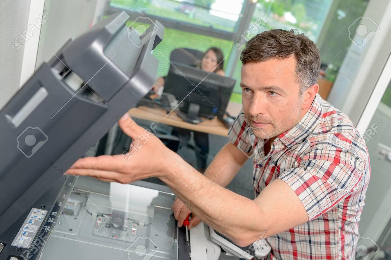 Fixing a printer Stock Photo - 37724804