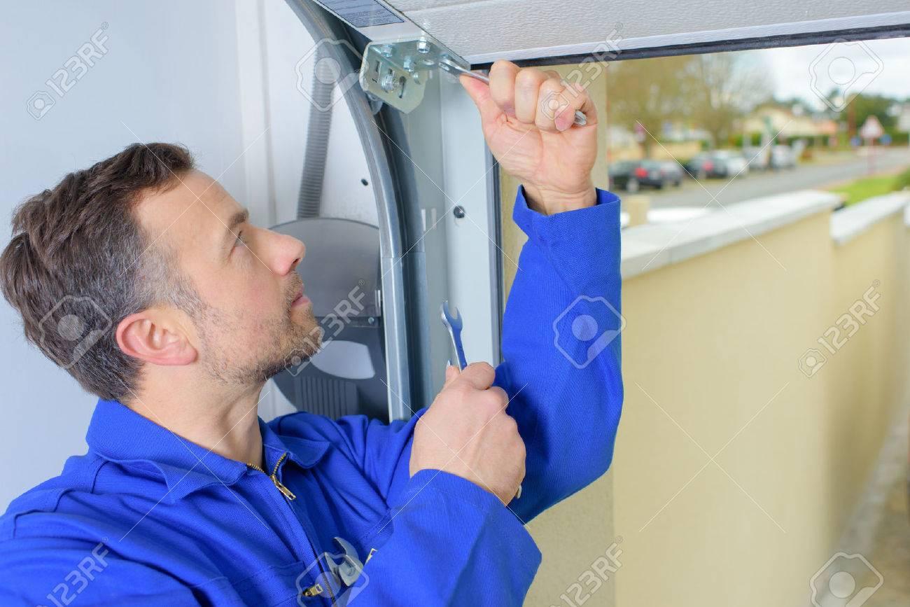 Man installing a garage door Stock Photo - 41888545