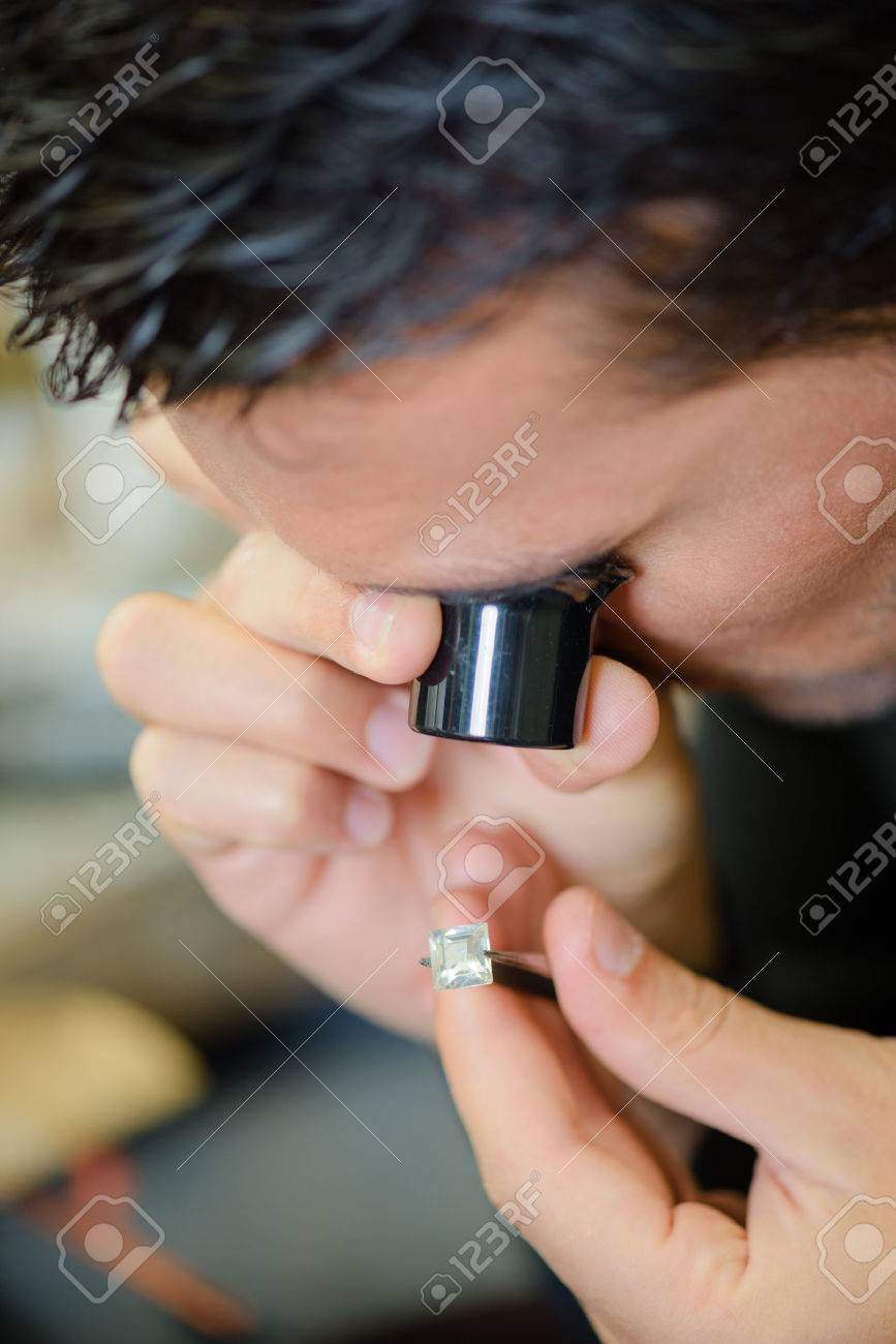 Jeweller appraising a ring Stock Photo - 42709585