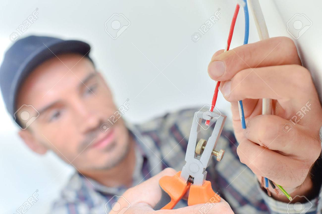 Electrician snipping a wire Stock Photo - 44435892