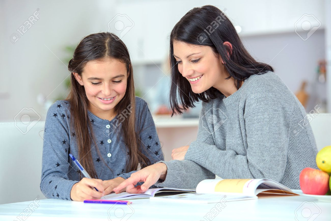 Mom helping her daughter do her homework Stock Photo - 45412699