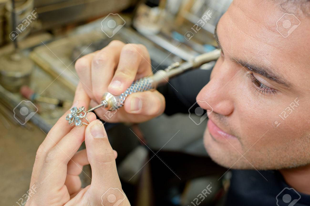 Skilled jeweller repairing a ring Stock Photo - 45412739