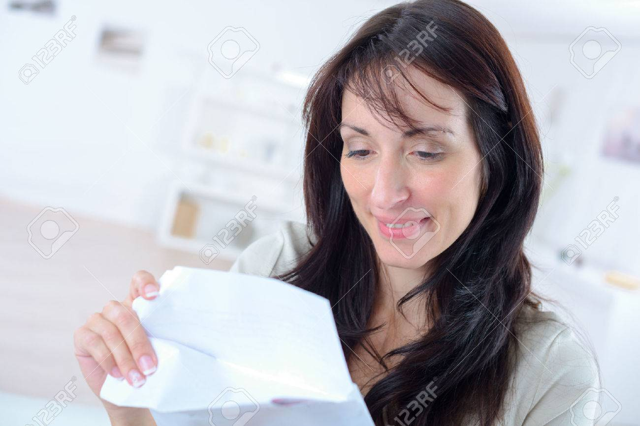 Woman opening a letter Stock Photo - 45867911