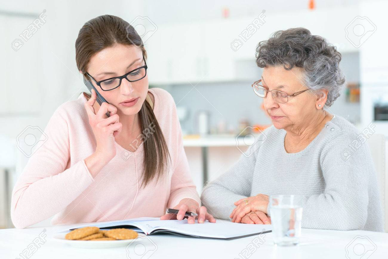 Helping senior lady with her finances Stock Photo - 46099312