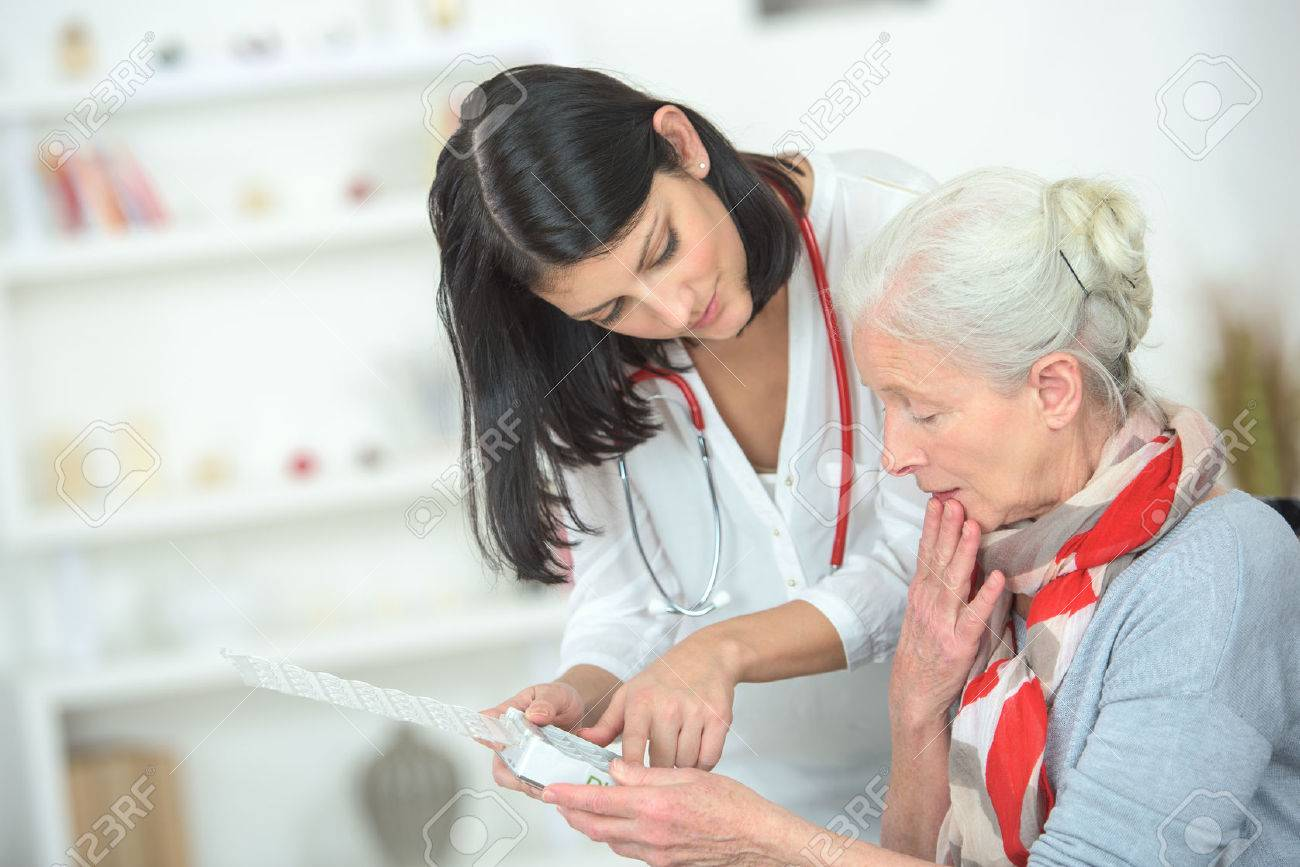Doctor explaining which pills to take and when Stock Photo - 46955028