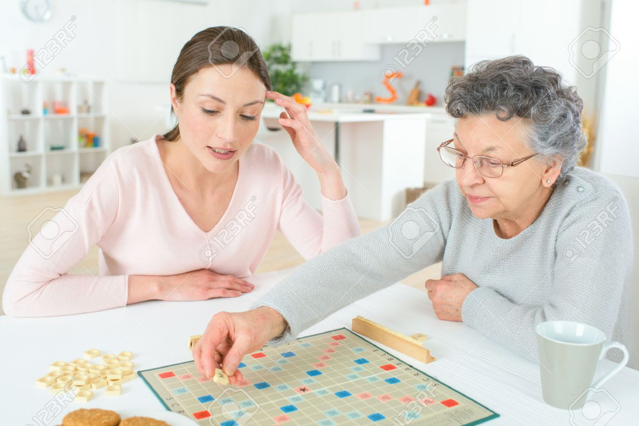 Elderly woman playing a board game Stock Photo - 47797484