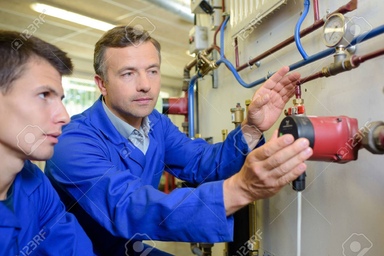 plumbing apprentice Stock Photo - 49262740