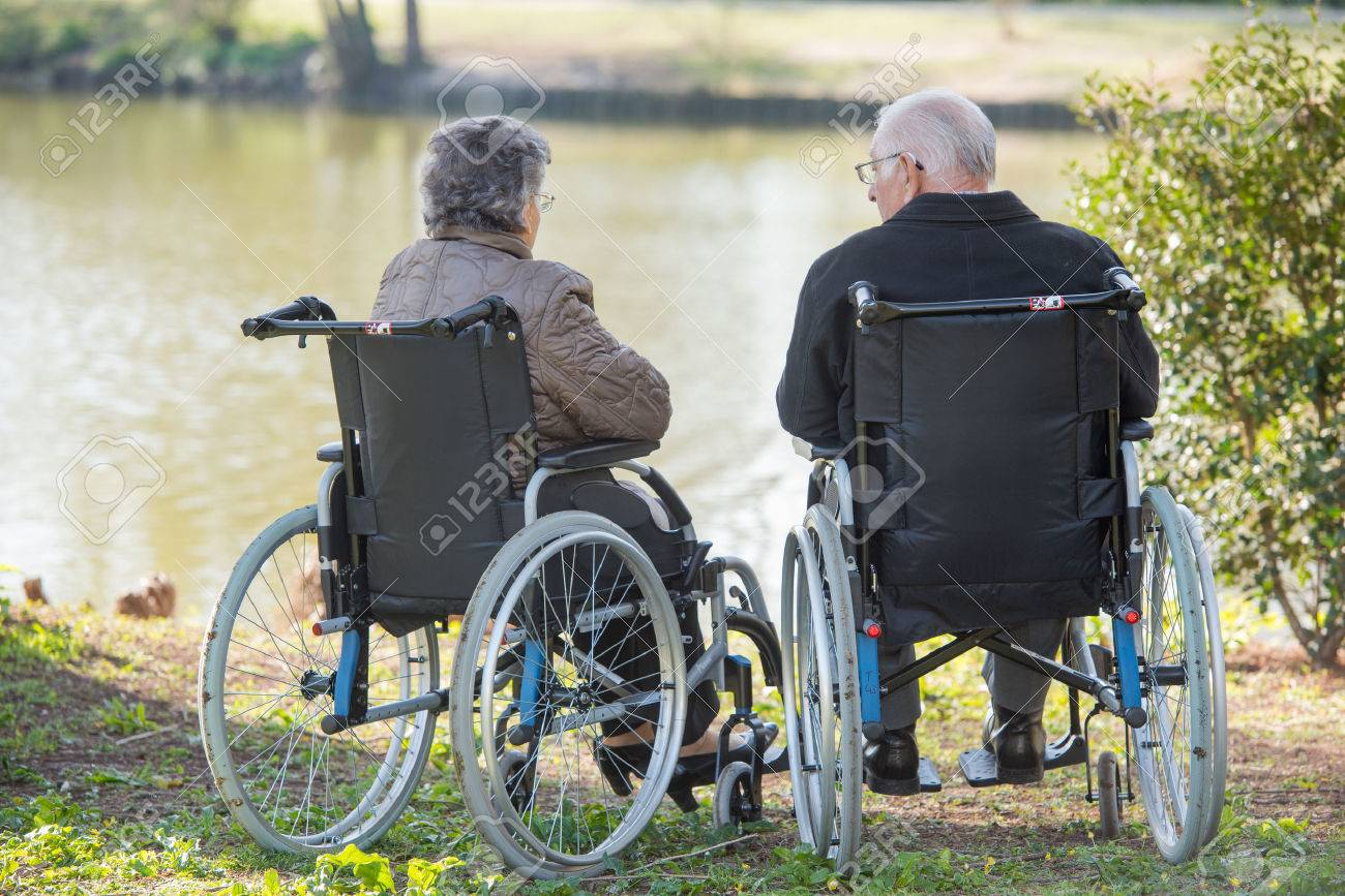 couple next to the lake Stock Photo - 49522988