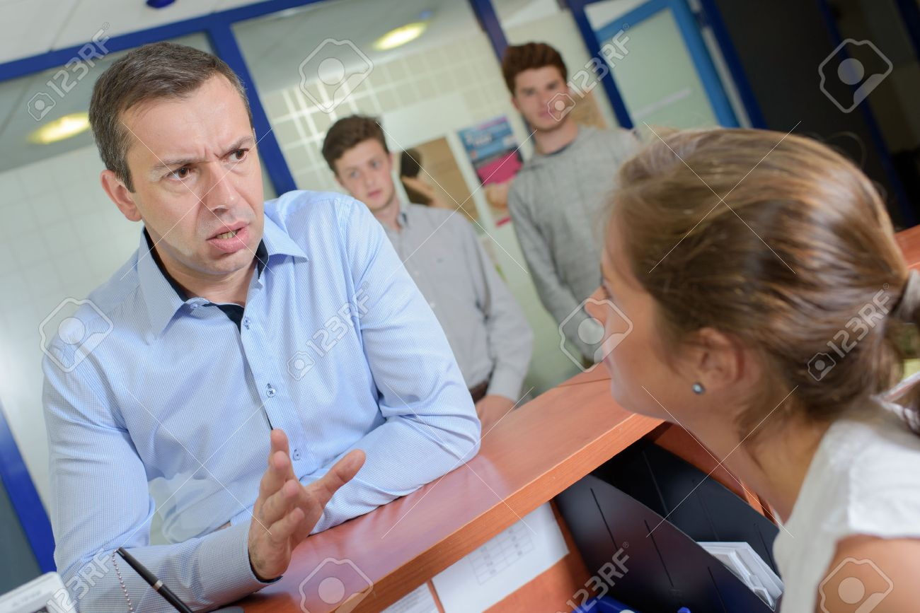 Man at reception desk getting angry Stock Photo - 49527478