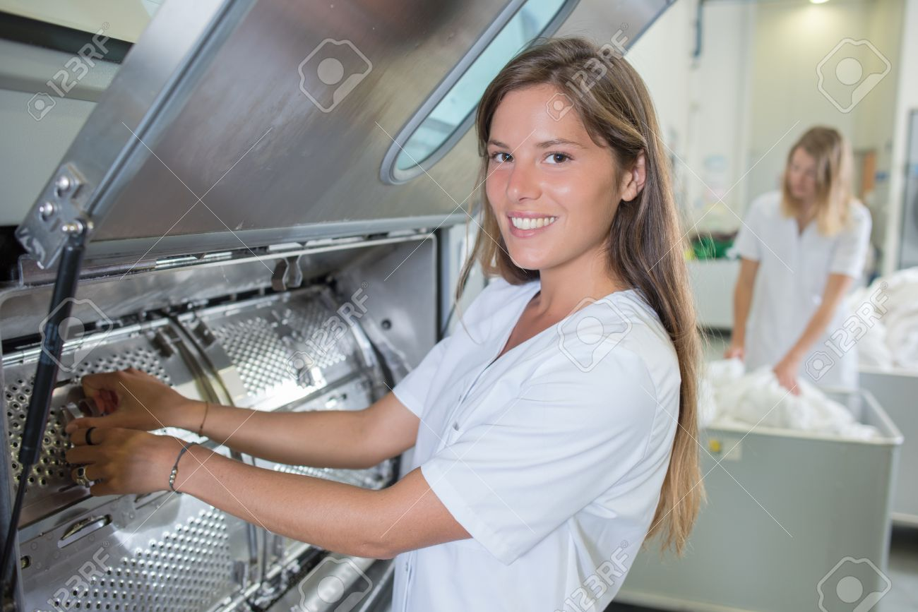Lady working in industrial laundry Stock Photo - 51230127