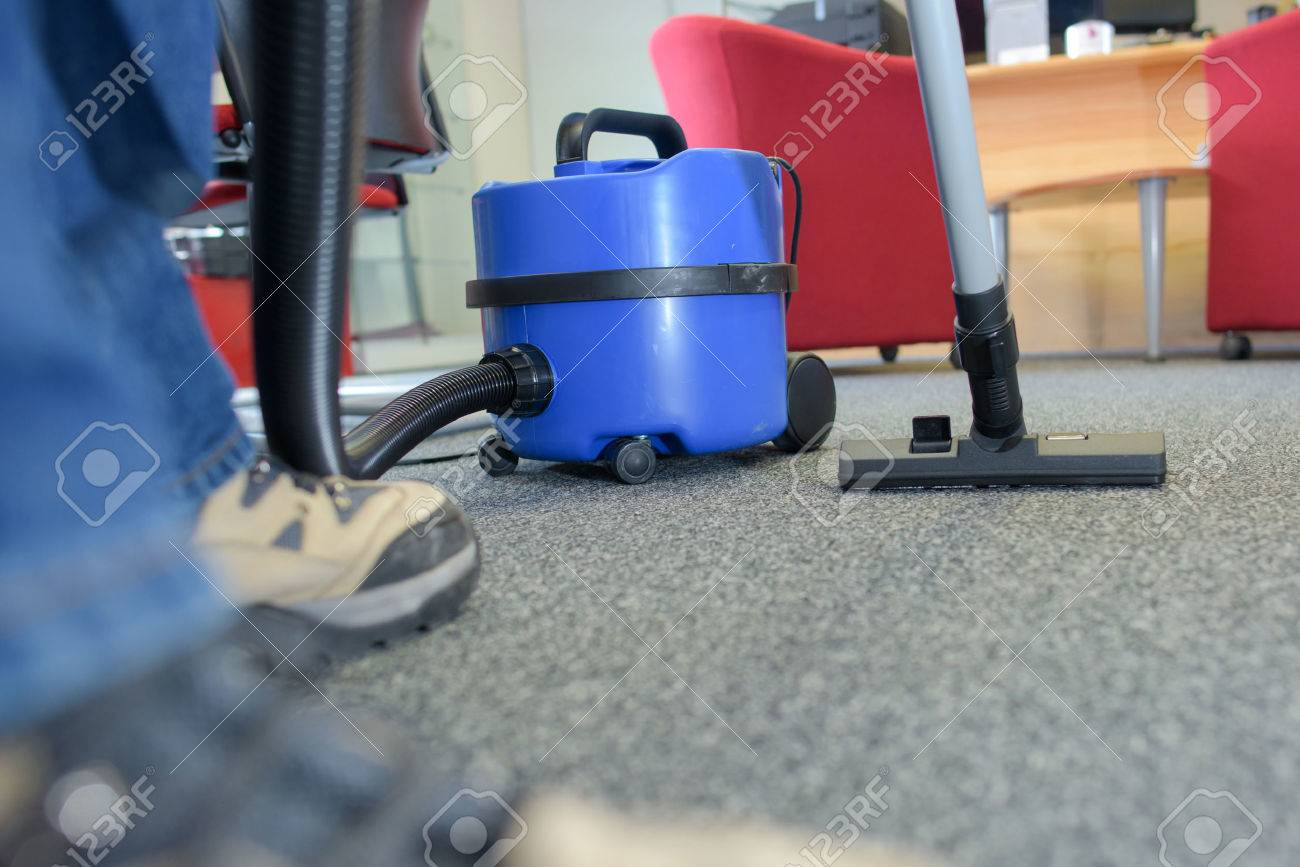 Cleaner with vacuum in the office Stock Photo - 55671346