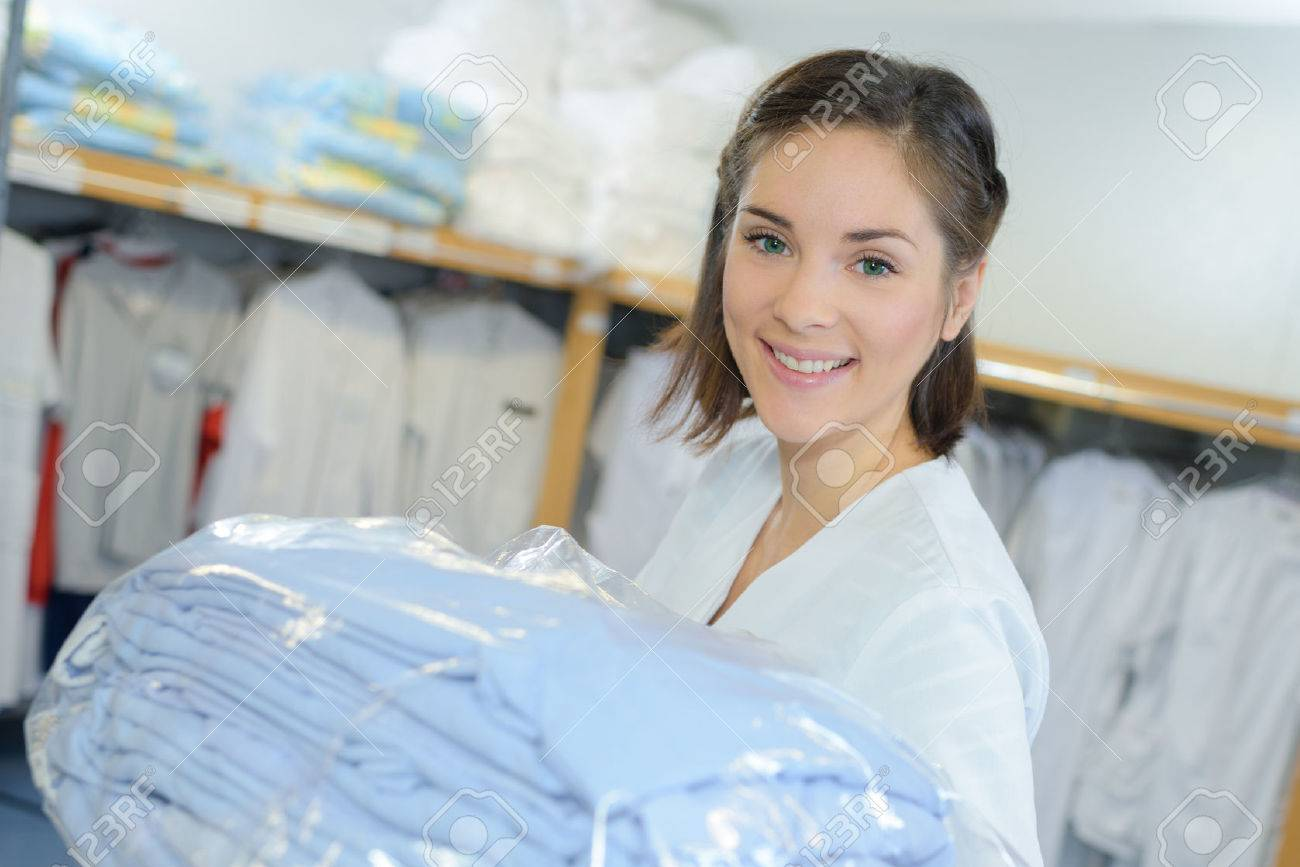 portrait of worker putting away laundry in hospital - 62931231