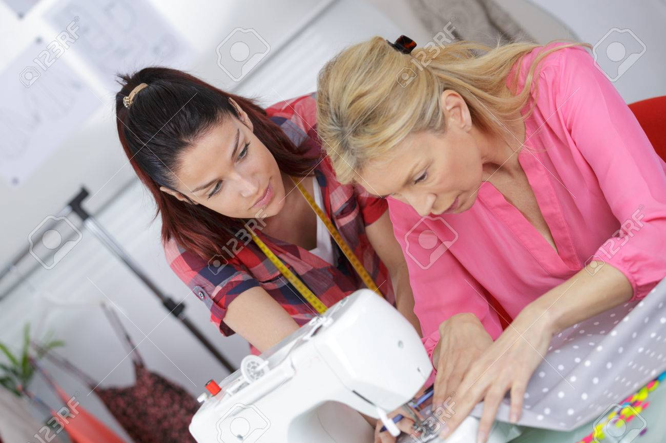 Fashion Designer Using Sewing Machine Training An Apprentice Stock Photo Picture And Royalty Free Image Image 66781529