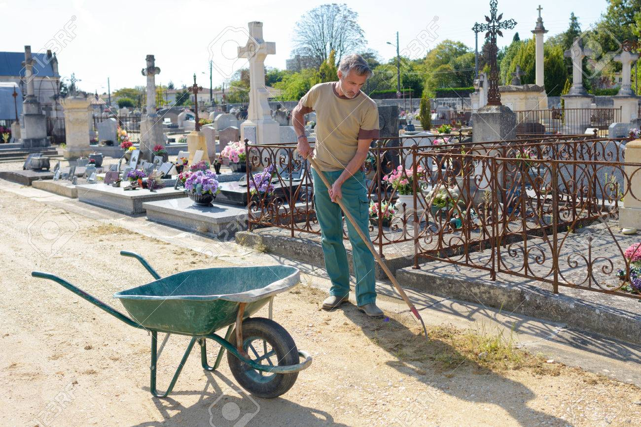 groundskeeper in cemetery stock photo picture and royalty free