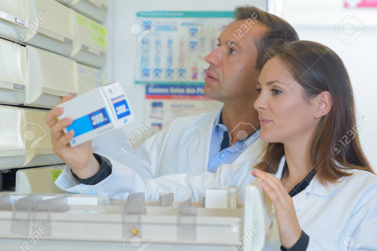 pharmacist inspecting the stocsk - 71380327