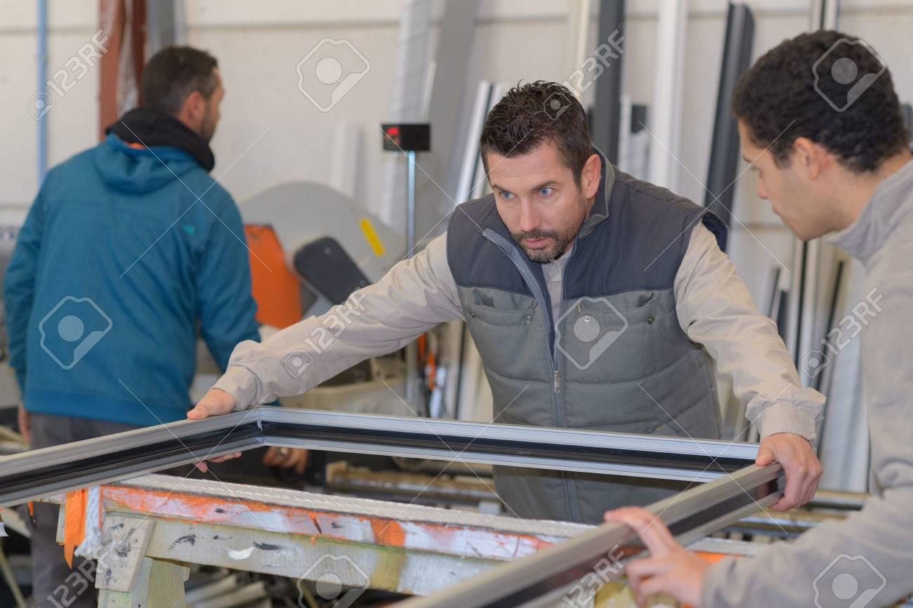 men working at plastic door and window factory - 78270666