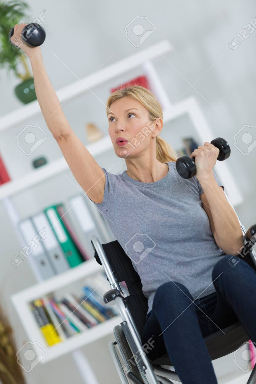 Disabled female staying fit at home stock photo picture and