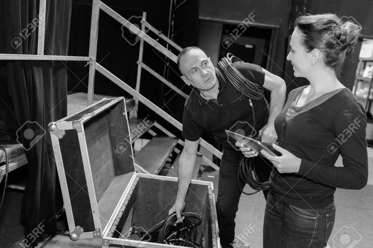 2 stage technicians preparing the stage for tonights show - 83101083
