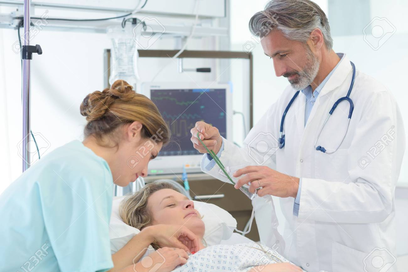 doctor nurse and female patient in bed - 88263970