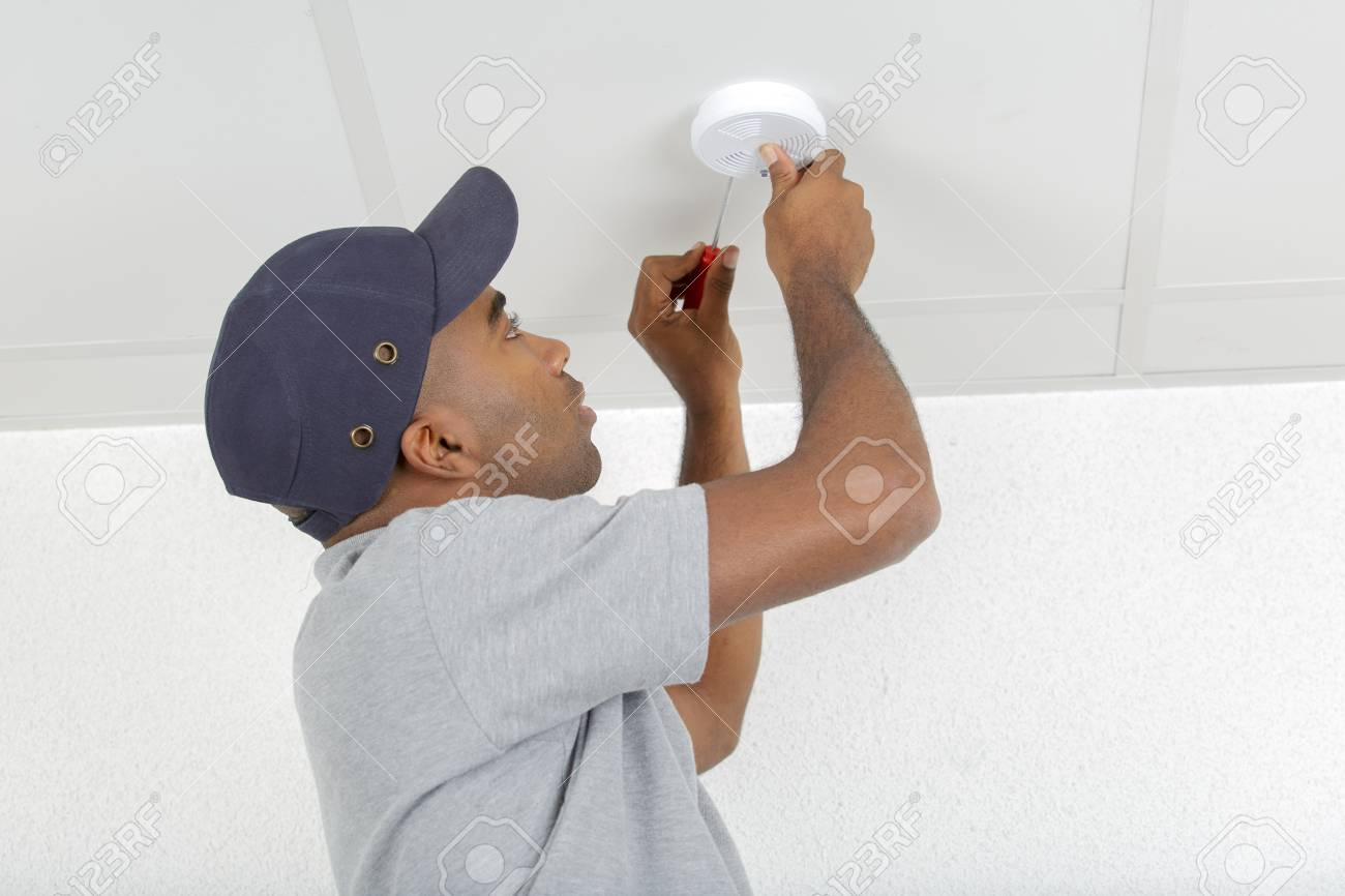 Mid Adult Man Fixing Light Bulb Wiring In New House Stock Photo A 88460951