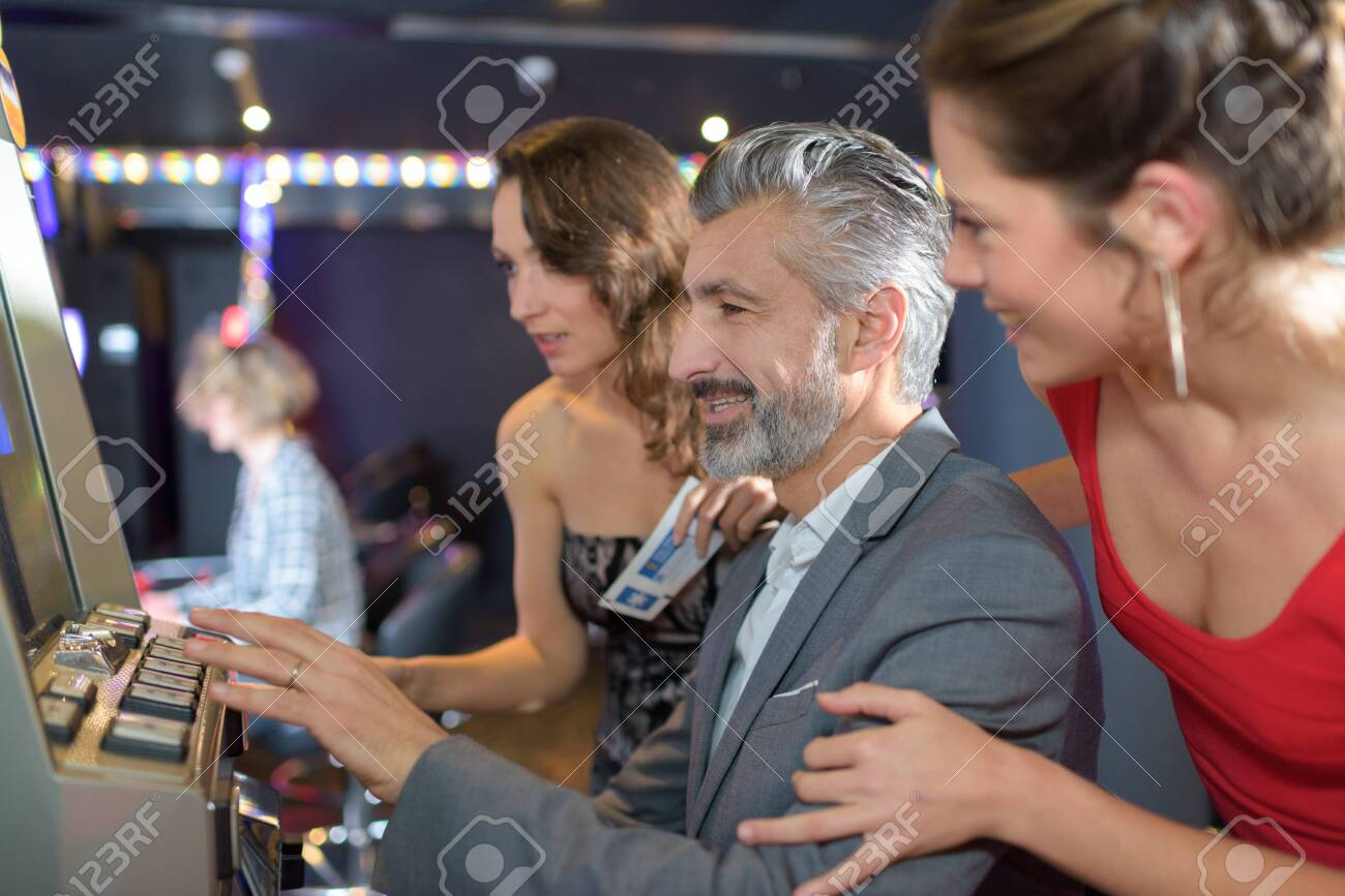man and women in a luxury casino interior - 125362560