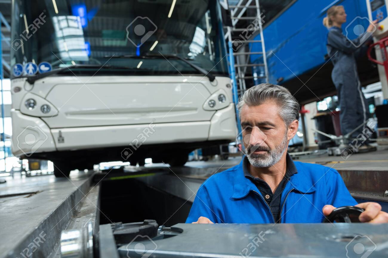 man working in bus garage - 138446446
