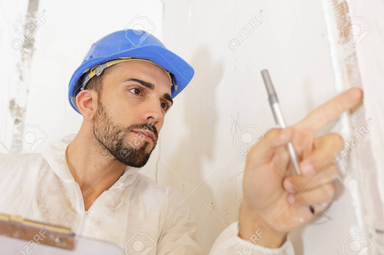 young man inspecting building site - 139350022