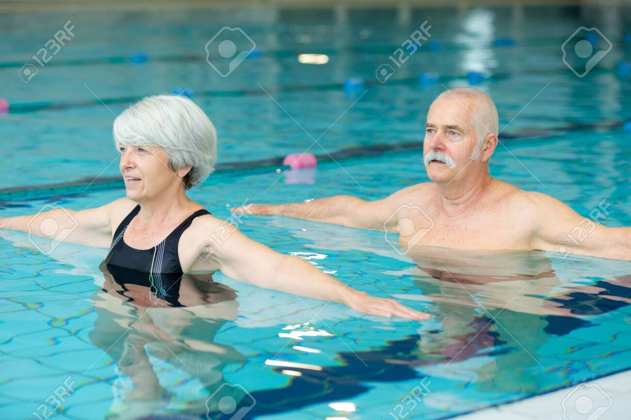 male and female elders doing aqua exercises - 141023971