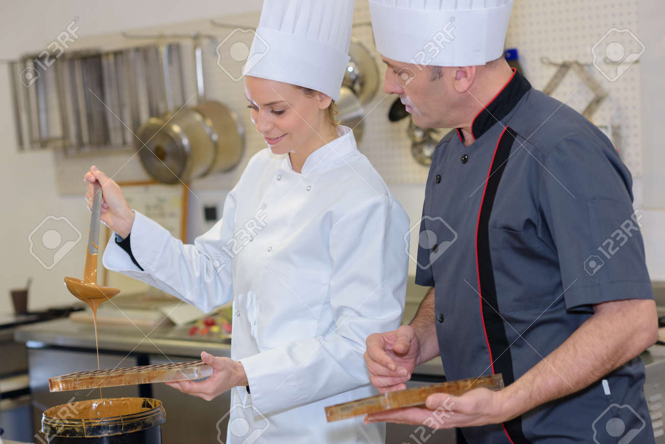 chef and assistant creating new pastries - 141757967