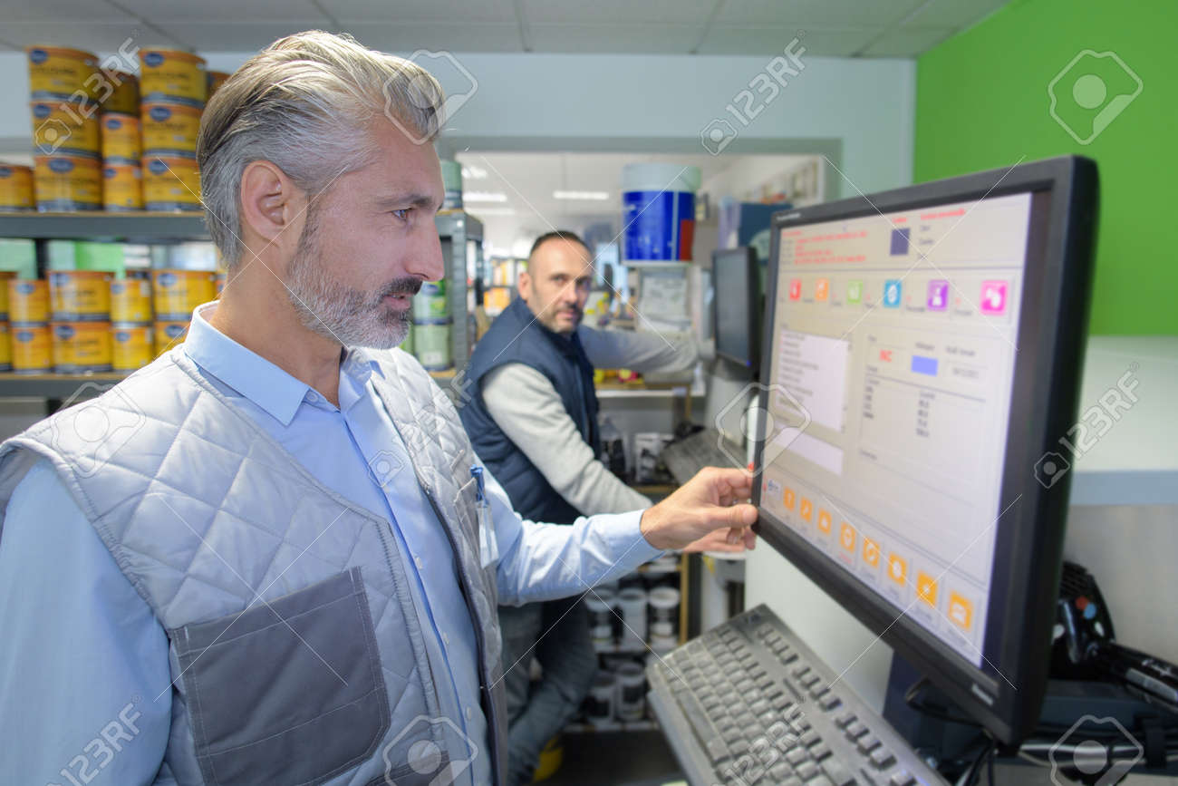 factory technician checking data on the screen - 157853252