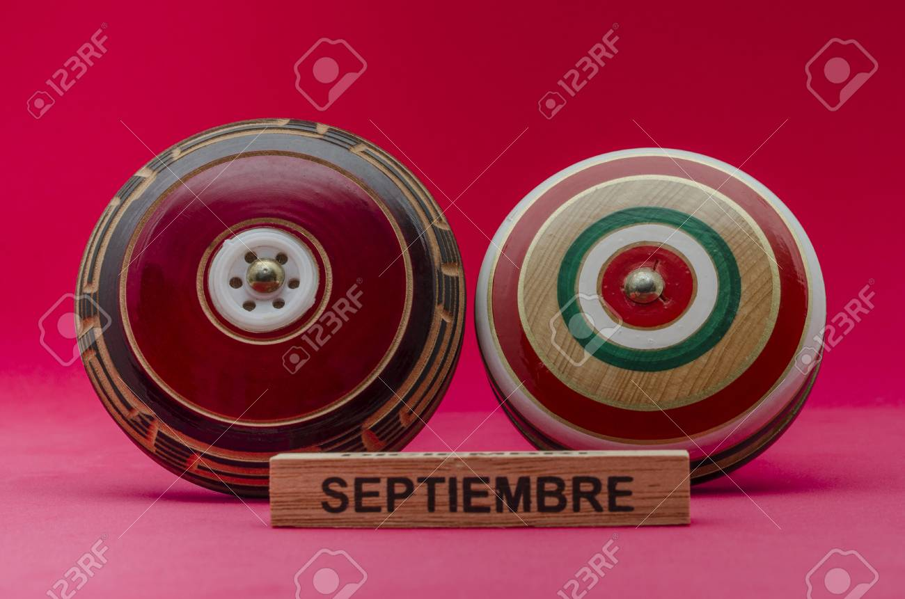 Wooden Retro Yoyos Against Red Background Wooden Mexican Toys