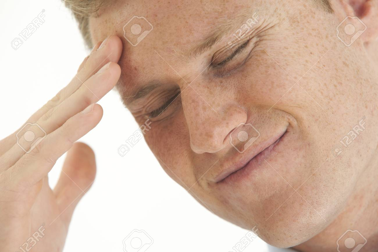 Stressed young businessman with hand on forehead Stock Photo - 7598082