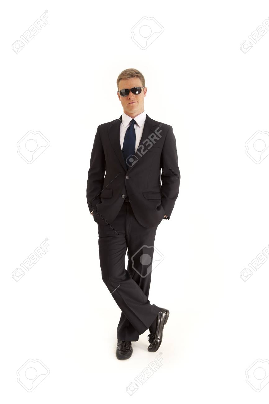 Confident young businessman wearing a suit and sunglasses Stock Photo - 7598170
