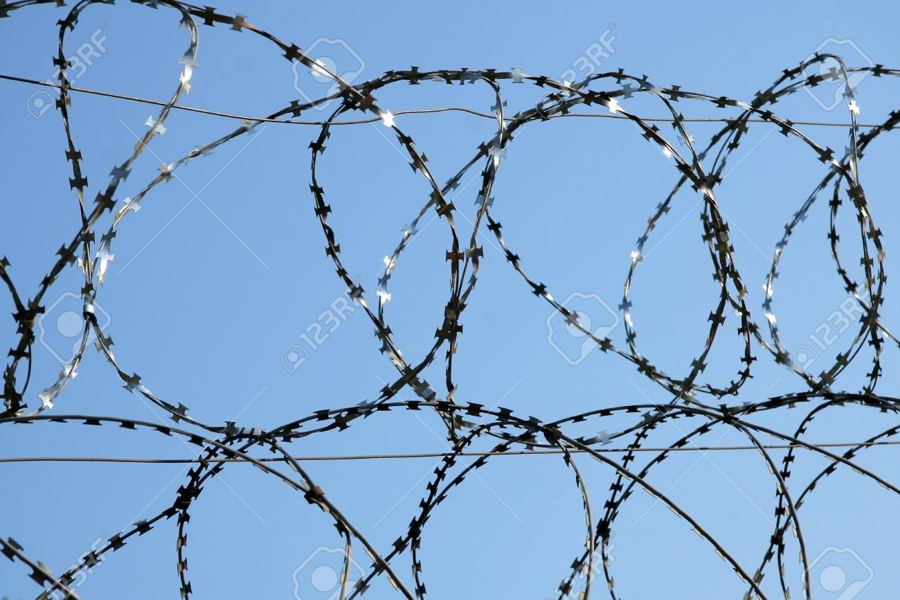 Barbed wire in two of some in the form of rings on a background of the sky Stock Photo - 3042374