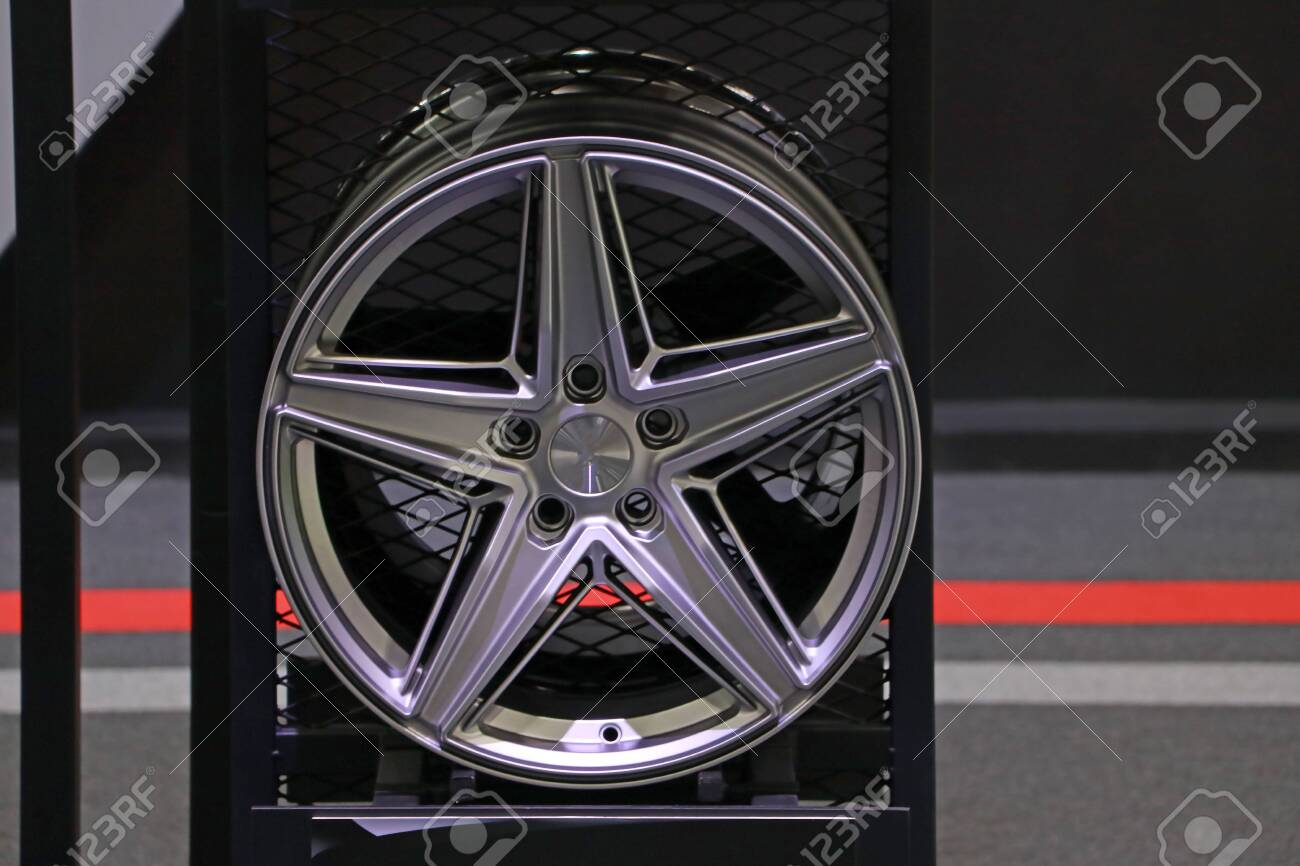 Alloy Wheel of car on the shelf. Alloy wheels are wheels that are made from an alloy of aluminium or magnesium. Alloys are mixtures of a metal and other elements. - 135778984