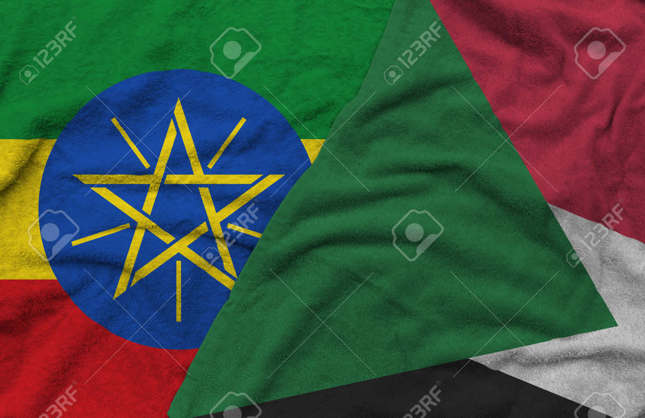 Ethiopia and Sudan flags pattern on towel fabric are placed together. It is the concept of the relationship between the two countries. - 158803102