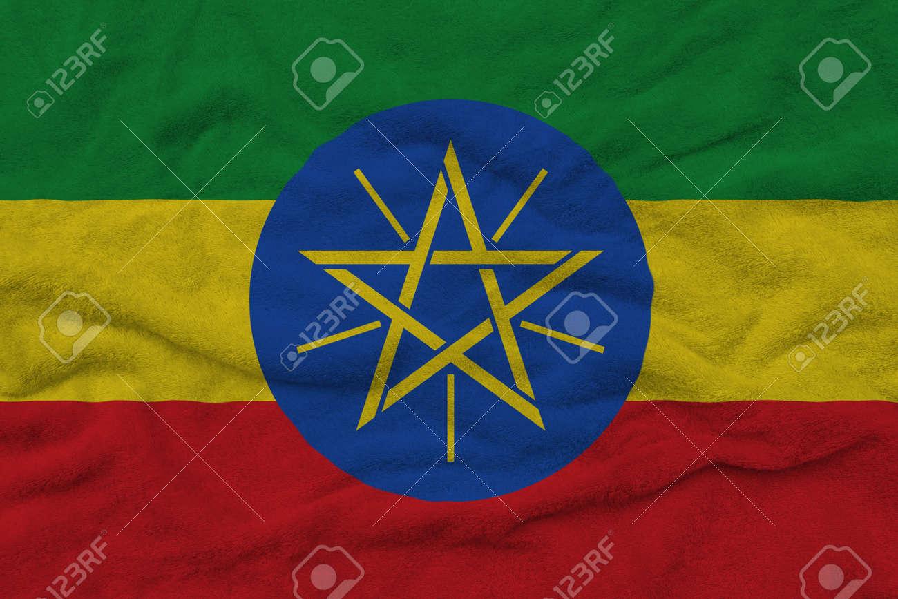 Ethiopian flag pattern on towel fabric, National flag of Ethiopia on fabric texture. - 159303144