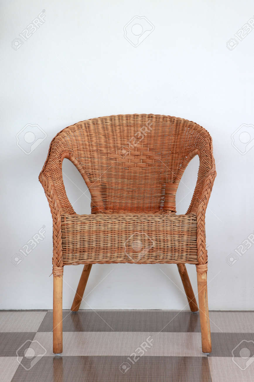 Rattan chair Cane chair or Wicker chair on the floor with white wall. - 160091995