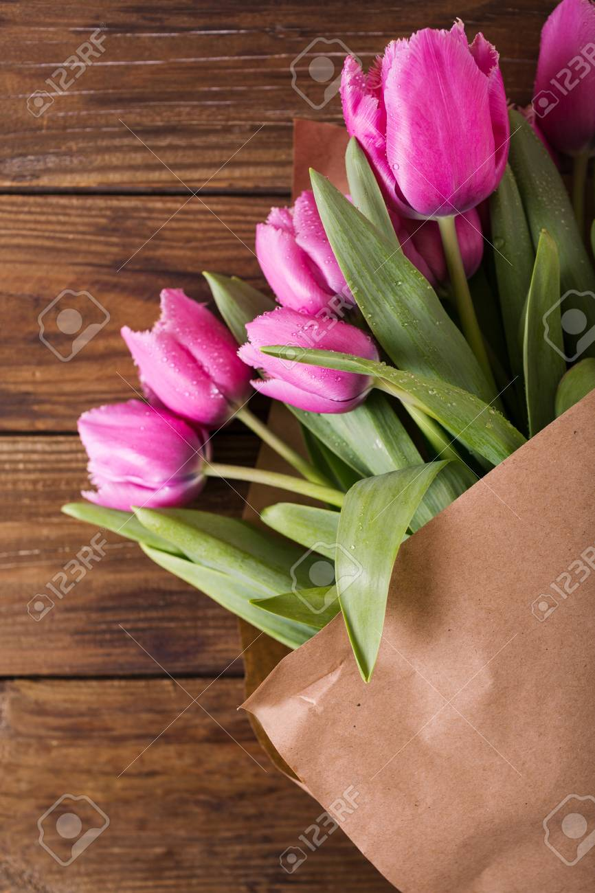 Pink Tulips In A Package Of Craft On The Wooden Background Pink
